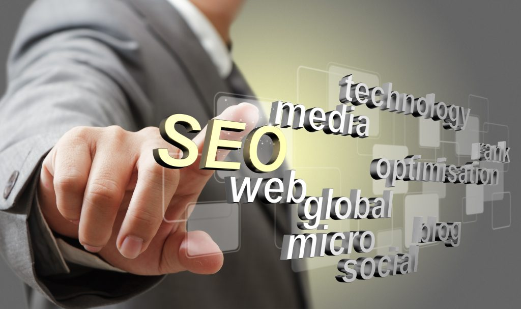 business man hand touch 3d SEO search engine optimization as concept